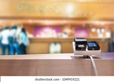 Look out of the payment counter, blur image of the tourist are contacting the hotel as background.