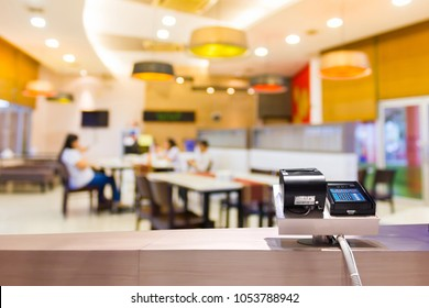 Look out from the payment counter, blur image of inside the restaurant as background.