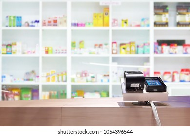 Look out from the payment counter, blur image of inside the drugstore as background.