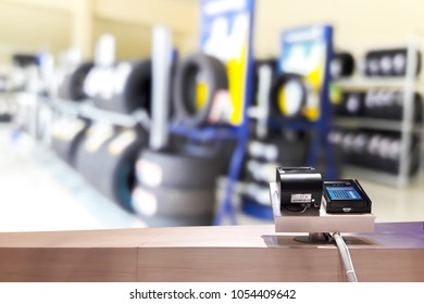 Look out from the payment counter, blur image of tire shop as background.