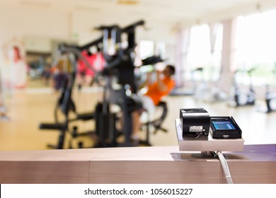 Look out from the payment counter, blur image of inside the gym as background.