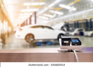 Look out from the payment counter, blur image of blur image of car service as background.