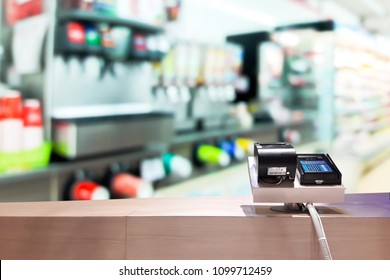 Look out from the payment counter, blur image of inside the convenience store as background.