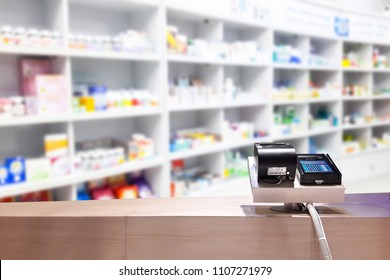 Look out from the payment counter, blur image of drugstore as background.