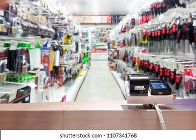 Look out from the payment counter, blur image of tools shop as background.