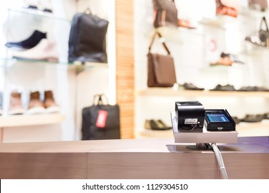 Look out from the payment counter, blur image of shoe shop in department store as background.