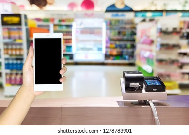 Look out from the payment counter, blur image of cosmetic shop in department store as background.