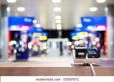 Look out from the service counter, blur image of inside gas station at night as background.
