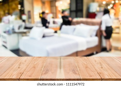 Look out from the table, blur image of mattress shop as background.