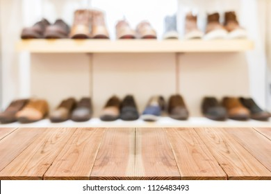 Look out from the table, blur image of shoe shop as background.