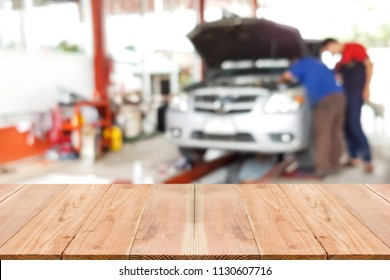 Look out from the table, blur image of inside garage as background.