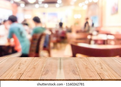 Look out from the table, blur image of inside the coffee shop as background.