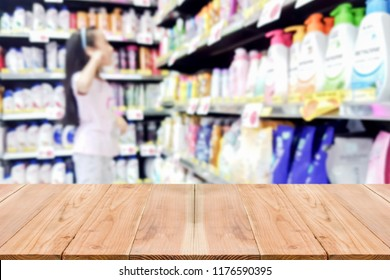Look out from the table, blur image of Asian kid choose shampoo by her self as background.