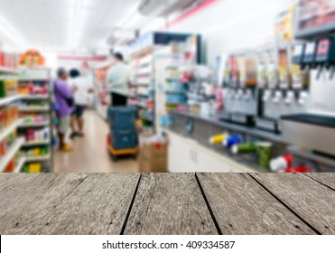 Look out from the table, blur image of inside convenience store as background.