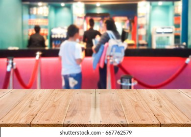 Look out from the table, blur image of movie ticket box as background.