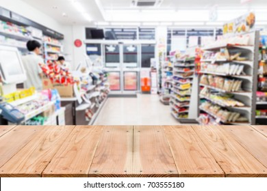 Look out from the table, blur image of inside the convenience store as background.