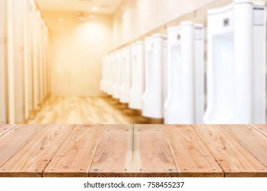 Look out from the table, blur images of inside the male toilet as background.
