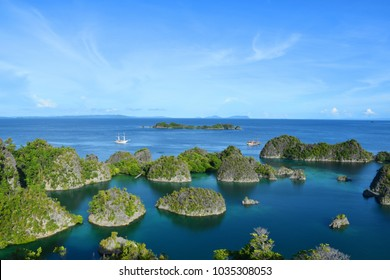 Look out from view point on top of Piaynemo Island, Raja Ampat, West Papua, Indonesia, with thick forest and lots of birds
