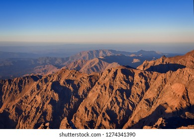 Look at peaks surrounding the highest summit of the Atlas mountains - Jebel Toubkal. The photo was taken early in the morning just after the sunrise. Morocco, 2018