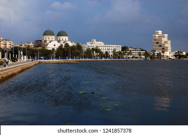 Look at the port of Benghazi. There is a lot of trash in the water. On the horizon is the only Christian church in Libya. Benghazi, Libya, April 6, 2011.