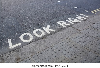 Look Right - painted instruction on the road at a pedestrian crossing