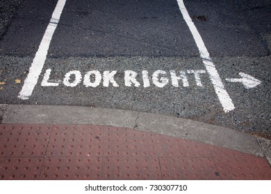 Look Right painted on road