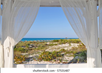 Look through beach house window. Cuba, Caribbean