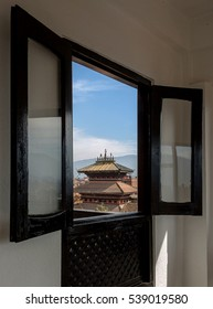 Look through the current window at the ancient temple in Bhaktapur - Nepal