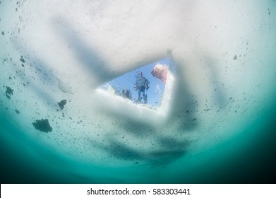 Look through Ice hole from underwater