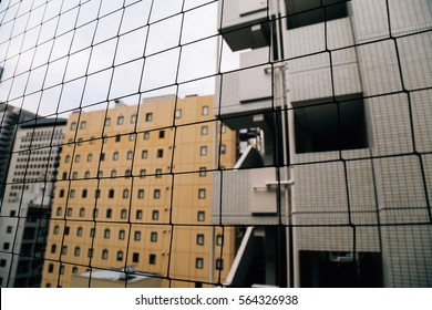 Look through the net at balcony with background of residential buildings in film tone.