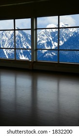 look through a window and snow mountain