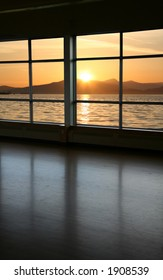 look through a window and sunset