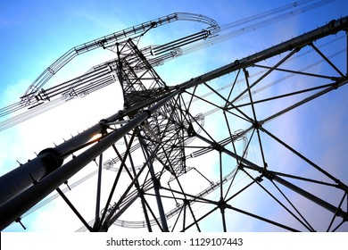 Look up at transmission tower on blue sky background