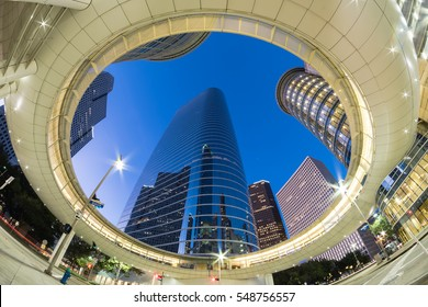 Look up view of Houston Downtown modern skyscrapers at blue hour.