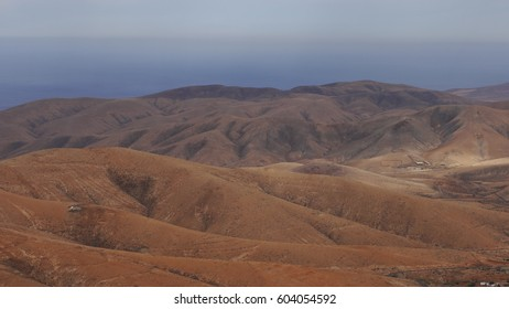 A look at the volcanic landscape - a desert in brown and red colors in the central part of the island Fuerteventura, Canary Islands, Spain.