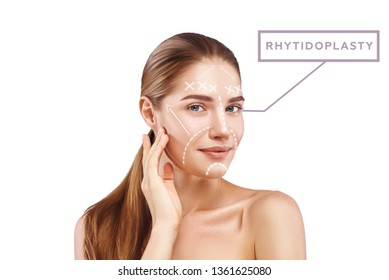 Look Younger with Rhytidoplasty. Portrait of attractive young woman touching her perfect skin with graphic lines and arrows on it. Isolated on white background. Lifting skin concept