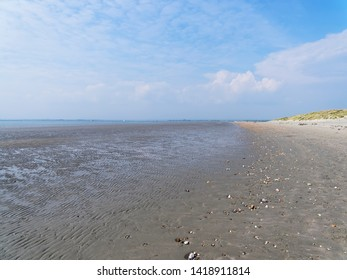 Looking across a deserted West Wittering beach at low tide