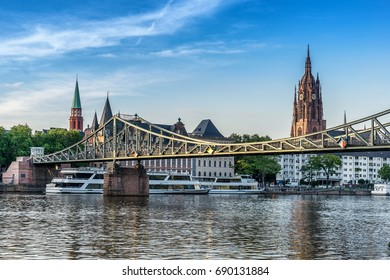 looking across to the Eiserner Steg bridge and Cathedral in Frankfurt Am Main