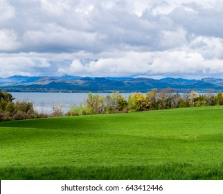 looking across farm meadow to Lake Champlain, Vermont , across to mountains in New York state