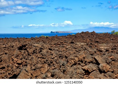 Looking across fields of lava rock towards Molokini and the West Maui Mountains