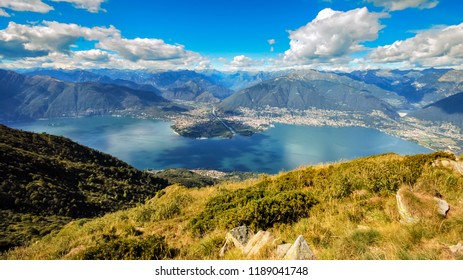 Looking across the Lake Locarno (Ticino, Switzerland) from a mountain peak near the village of Indemini on a summer day. The cities of Ascona and Locarno are lying next to the lake.