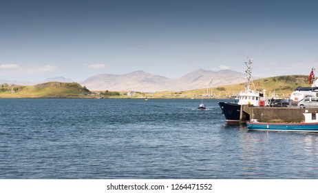 Looking across Oban Bay to the Isle of Kerrera and the distant mountains of the Isle of Mull from Oban in the west Highlands of Scotland.