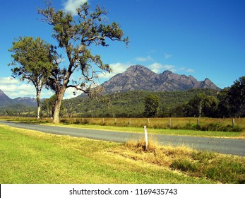 Looking across open grazing land towards  Mount Barney,which is surrounded by the wild Gondwana Rainforests of Queensland, Australia, a World Heritage Area.