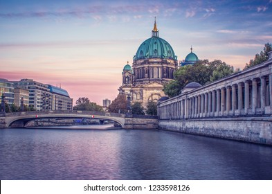 Looking across the river at the Berlin Cathedral during a colorful sunset