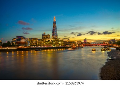 Looking across the River Thames with the London city skyline at sunset