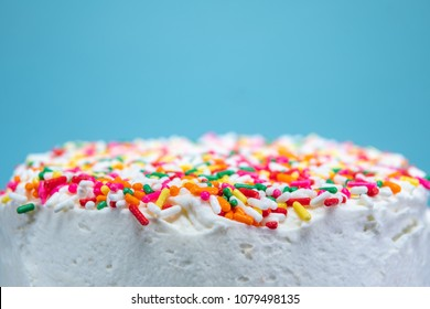 Looking Across Sprinkles on Cake with aqua background