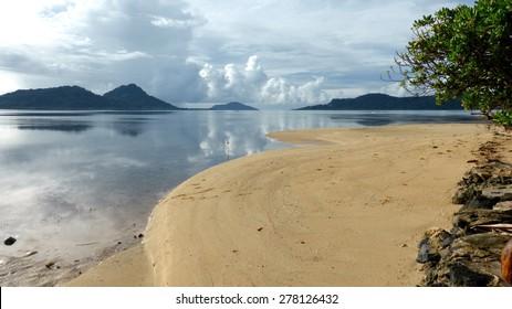 Looking across Truk/Chuuk Lagoon from a beach on Moen/Weno Island.