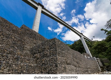 Looking up at Agas Agas bridge, the tallest bridge in the Philippines.Stone riprap abutment protects the foundation of the bridge. Located in Sogod, Leyte.