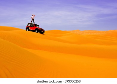 Looking ahead concept: jeep car and lonely man in the sand desert.