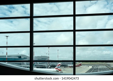 Looking to the  airport through the terminal window.